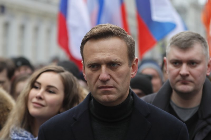 Russian opposition leader and anti-corruption activist Alexei Navalny (C) takes part in a memorial march for Boris Nemtsov marking the fifth anniversary of his assassination in Moscow, Russia, 29 February 2020. (EPA Photo)