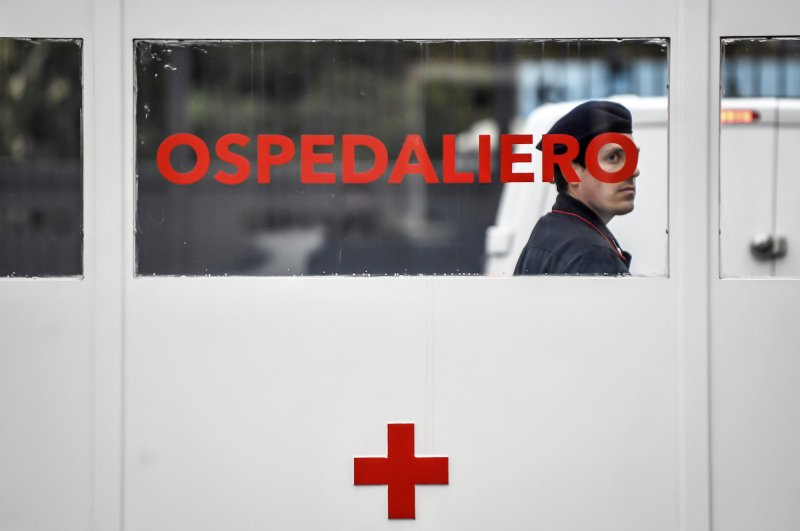 A Carabinieri (Italian paramilitary police) officer on patrol at former military hospital Baggio, which reopened a ward to hospitalize patients recovering from the COVID-19 virus, in Milan, Italy, Tuesday, March 2, 2020. (LaPresse via AP)