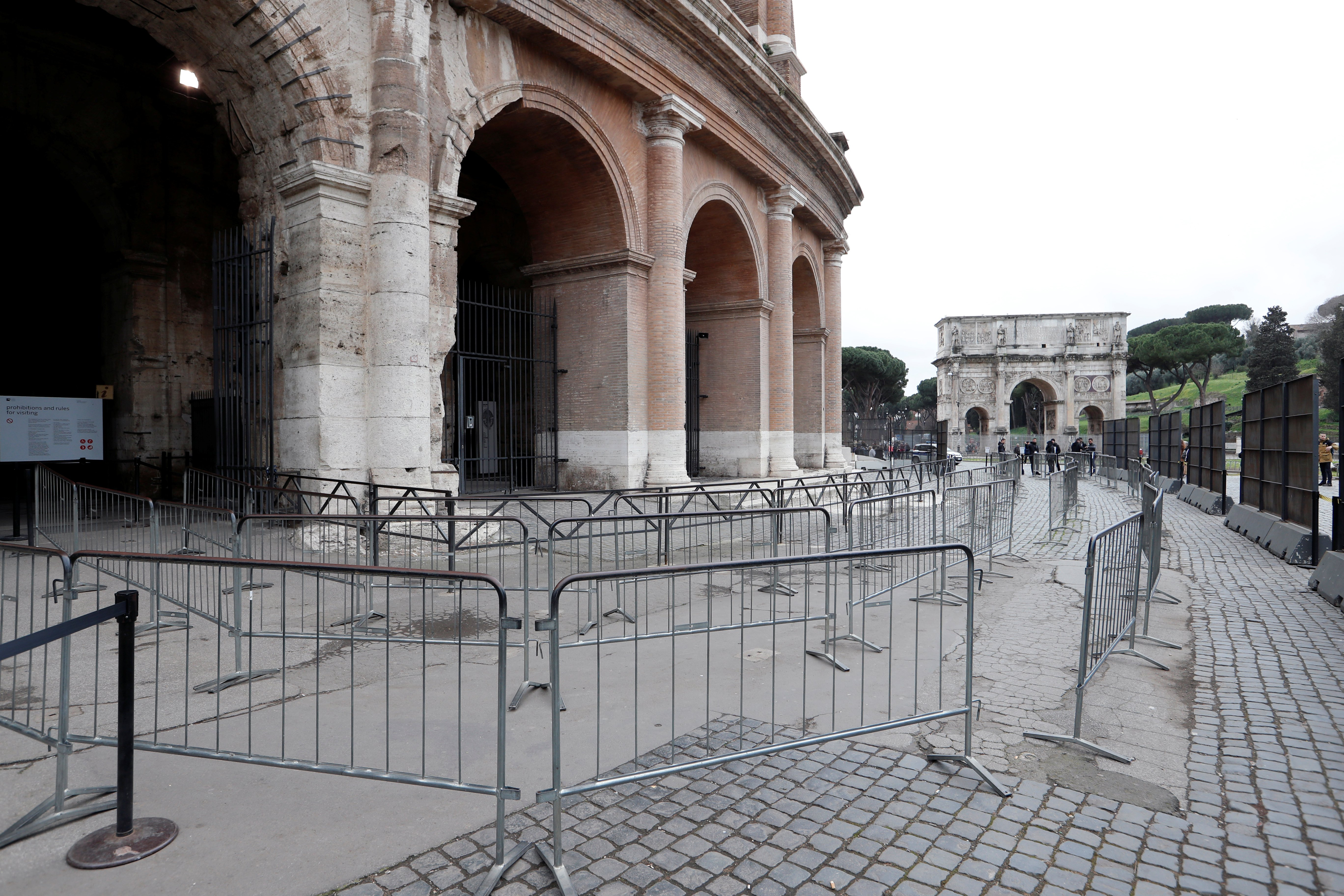 An empty pathway leading to the entrance of the Colosseum, where usually there would be a long queue of tourists waiting, is seen in Rome, Italy, March 2, 2020. (Reuters Photo)