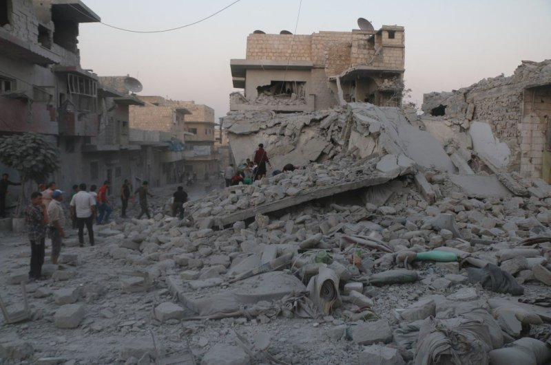 Residents inspect the rubble of damaged buildings and search for victims after a deadly airstrike in Maarat al-Numan, Idlib province, Syria, Aug. 28, 2019. (Reuters Photo)