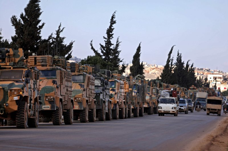 A Turkish military convoy is seen parked near the town of Batabu on the highway linking Idlib to the Syrian Bab al-Hawa border crossing with Turkey, March 2, 2020. (AFP Photo)