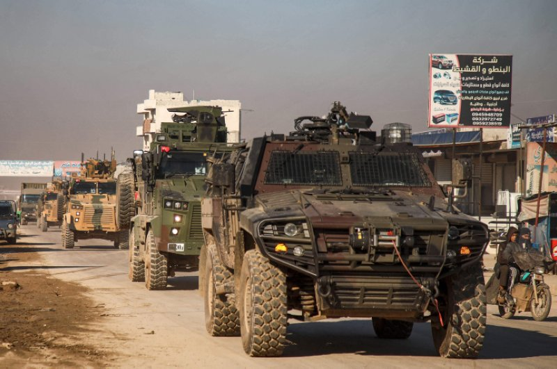 A Turkish military convoy of tanks and armored vehicles passes through the Syrian town of Dana, east of the Turkish-Syrian border in the northwestern Syrian province of Idlib, Feb. 2, 2020. (AFP Photo)