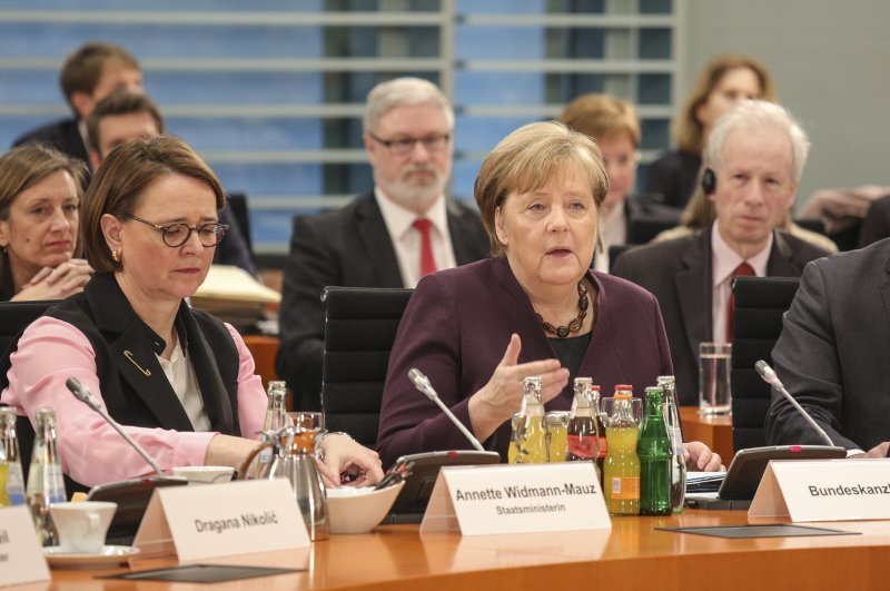 German Chancellor Angela Merkel (R) and Minister of State for Migration, Refugees and Integration Annette Widmann-Mauz (L) are seen during the 11th Integration Summit held at the federal chancellery in Berlin, Germany, March 02, 2020. (EPA Photo)