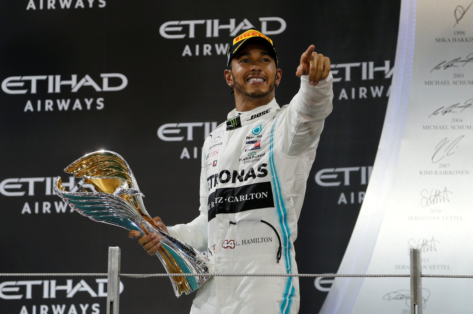 Lewis Hamilton celebrates with a trophy after winning the race, Abu Dhabi, Dec. 1, 2019. (REUTERS Photo)
