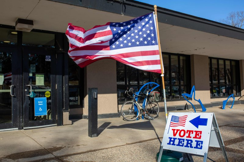 Signs are seen during the Democratic presidential primary at a polling station in Minneapolis, Minnesota on Super Tuesday, March 3, 2020. (AFP Photo)