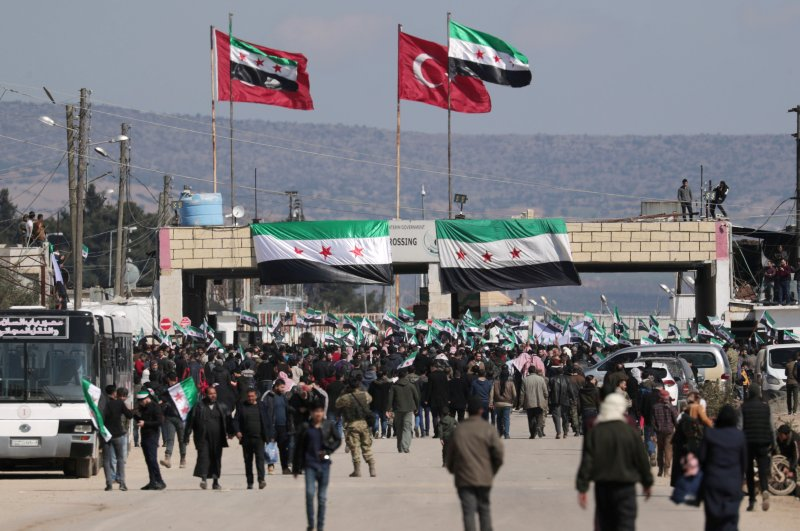 Internally displaced Syrians hold Syrian opposition flags during a protest in support of the Turkish army and the SNA at the Bab el-Salam border crossing between the Syrian town of Azaz and the Turkish town of Kilis, in Syria, Feb. 25, 2020. (Reuters Photo)