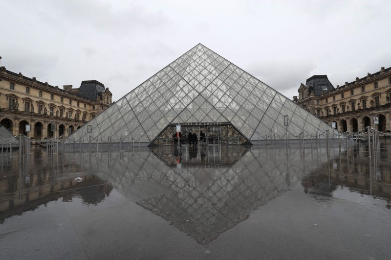 A view of the deserted courtyard outside the closed Pyramid, the main entrance to the Louvre museum which was once a royal residence, located in central Paris, March 2, 2020. (AFP Photo)