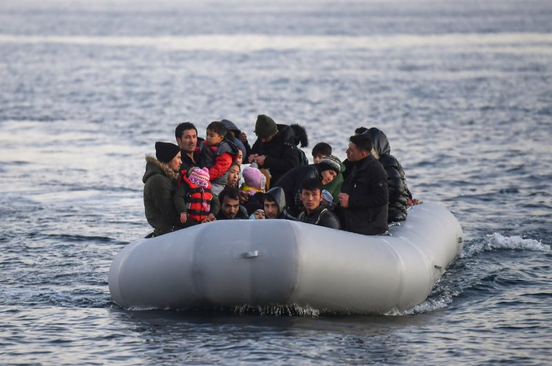 Refugees and migrants aboard an inflatable boat arrive in the Greek island of Lesbos, March 2, 2020. (AFP Photo)