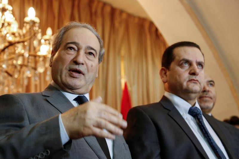 Syrian regime Deputy Foreign Minister Faisal al Mekdad stands next to Abdulhadi Lahweej, foreign minister of the illegitimate government of Khalifa Haftar, at a ceremony to open a Libyan embassy in Damascus, Syria, March 3, 2020. (Reuters Photo)
