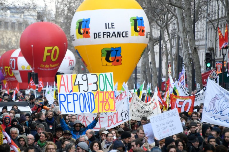 People take part in a demonstration called by several French workers unions, Paris, March 3, 2020. (AFP Photo)