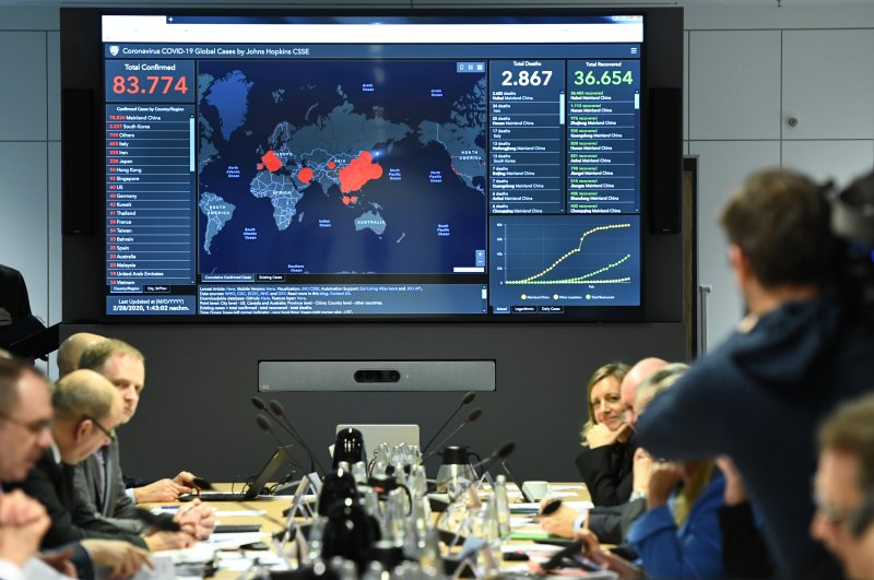 A display shows the latest information on the spread of the novel coronavirus worldwide during a crisis meeting of government officials in Berlin, Germany, Feb. 28, 2020. (Reuters Photo)