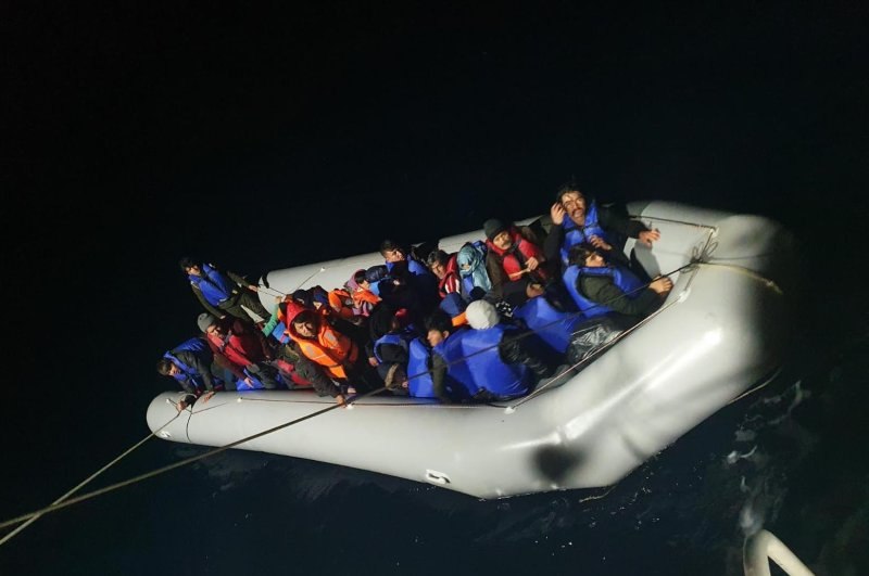 The Turkish coast guard rescued 130 Syrian and Afghan migrants off the coast of the Kuşadası district of Aydın province, March 5, 2020. (DHA Photo)