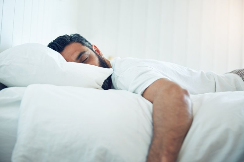 If sleeping on your stomach is your go-to snooze position, you might want to reconsider. (iStock Photo)