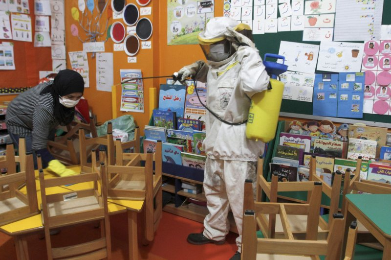 Lebanese workers spray disinfectant in classrooms and halls of a school in the coastal town of Rmeileh, Beirut, Feb. 2, 2020. (AFP Photo)