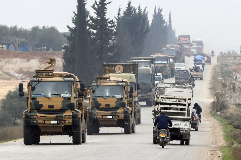 A Turkish military convoy drive in the east of Idlib, Syria, Friday, Feb. 28, 2020. (AP Photo)