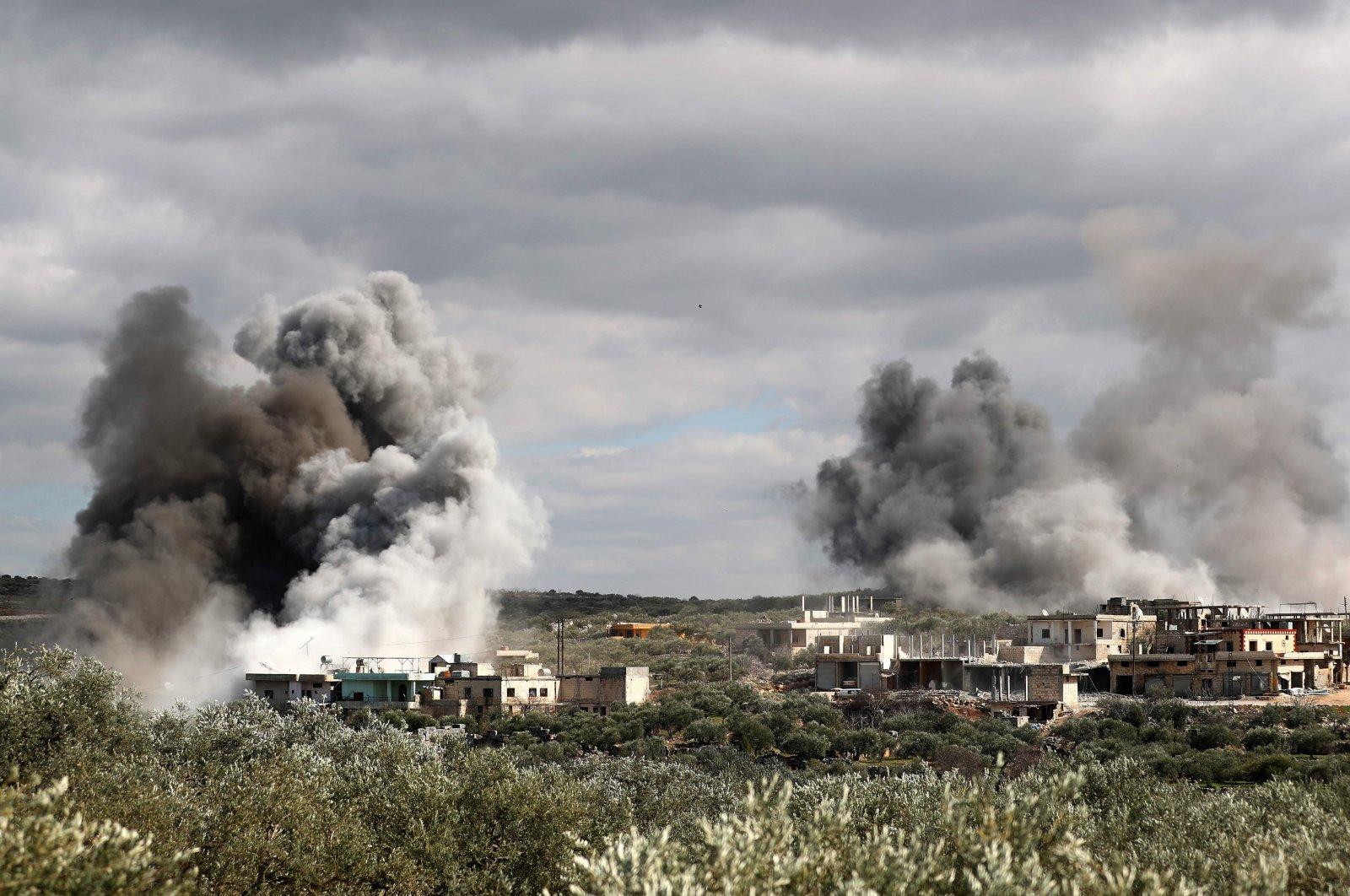 Smoke plumes rise after an aerial bombardment by Assad regime forces on the village of al-Bara in the southern part of the northwestern province of Idlib, March 2, 2020. (AFP Photo)