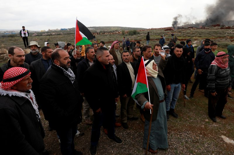 Palestinian demonstrators gather during a protest against Israeli settlements in the village of Qusra, in the Israeli-occupied West Bank, March 2, 2020. (REUTERS Photo)