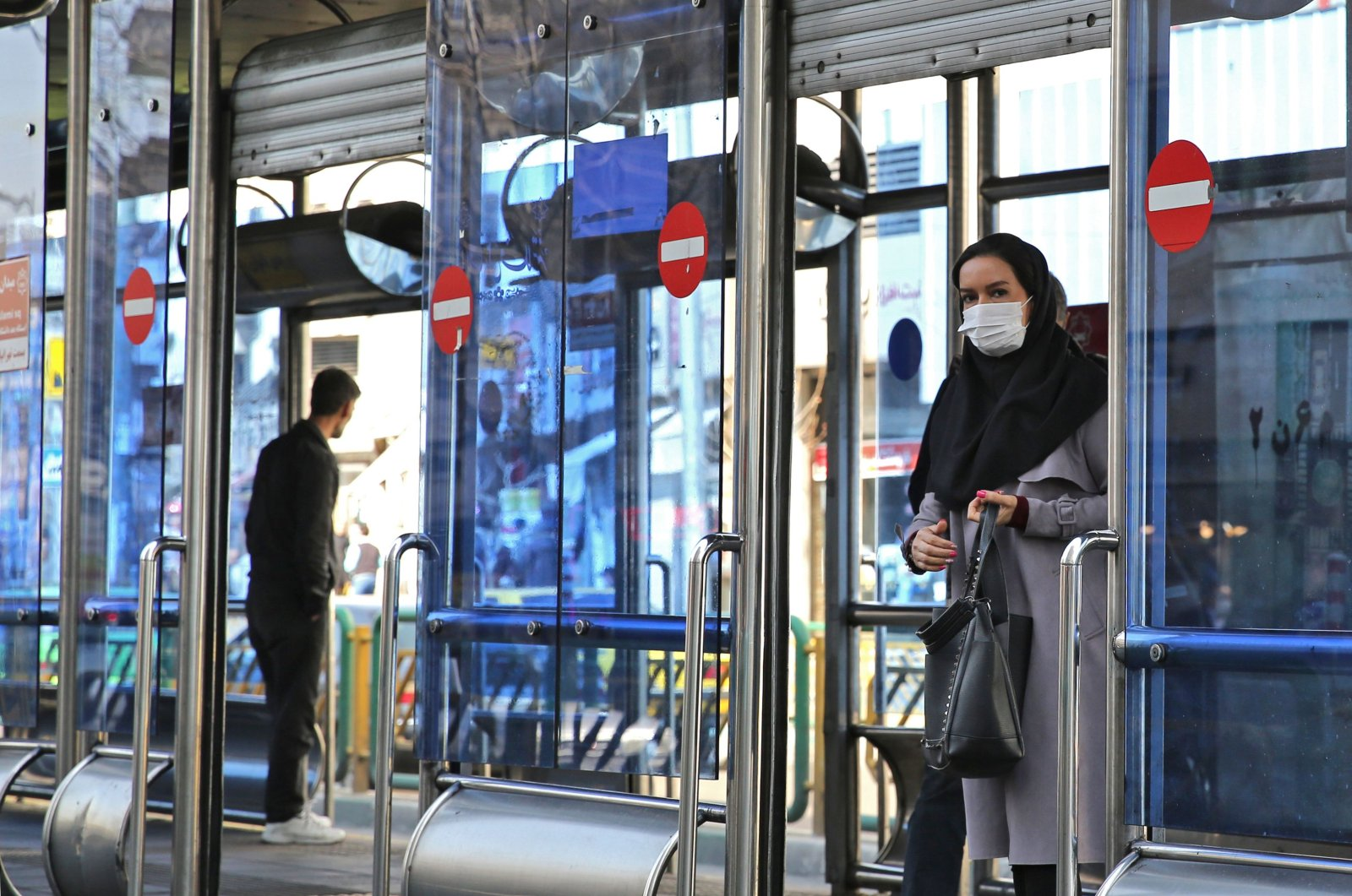 An Iranian woman wears a protective mask in the capital Tehran on March 4, 2020. (AFP Photo)