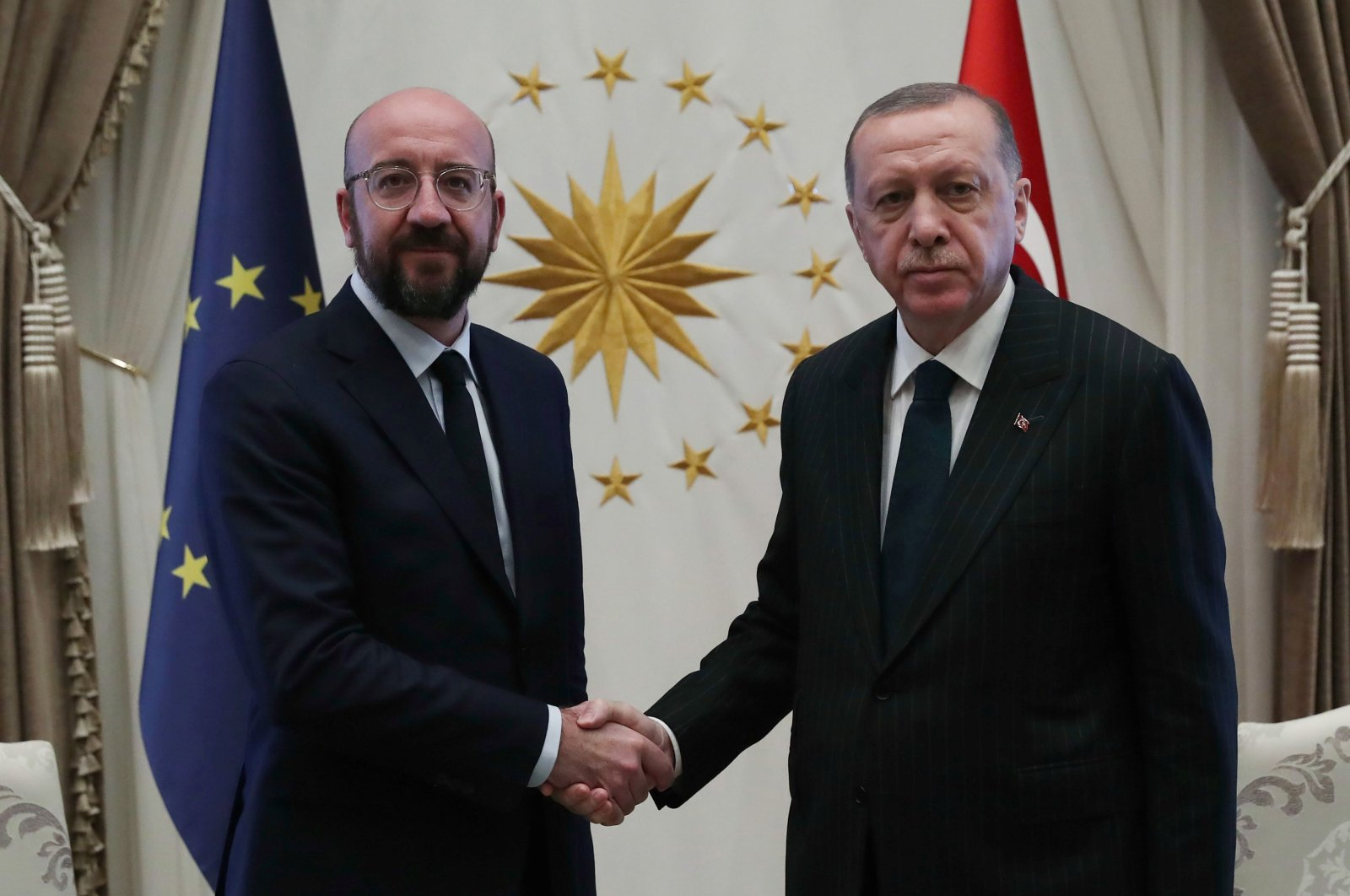 President Recep Tayyip Erdoğan (R) shaking hands with European Council's President Charles Michel (L) at the Presidential Complex in Ankara, on March 4, 2020. (AFP Photo)