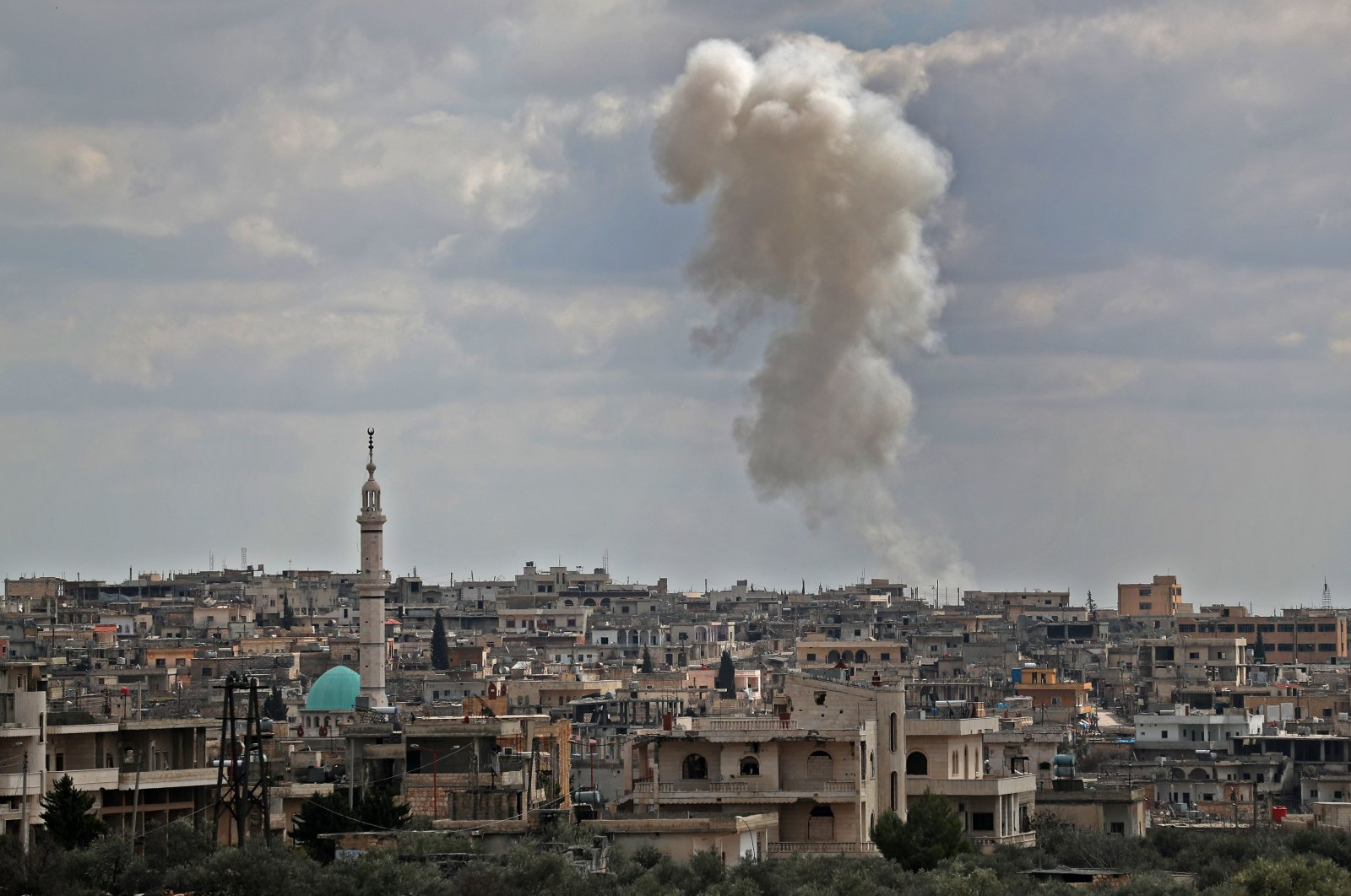Smoke plumes seen rising following aerial bombardment by Syrian regime forces on the village of al-Bara, northwestern Idlib province, Syria, March 2, 2020. (AFP Photo)
