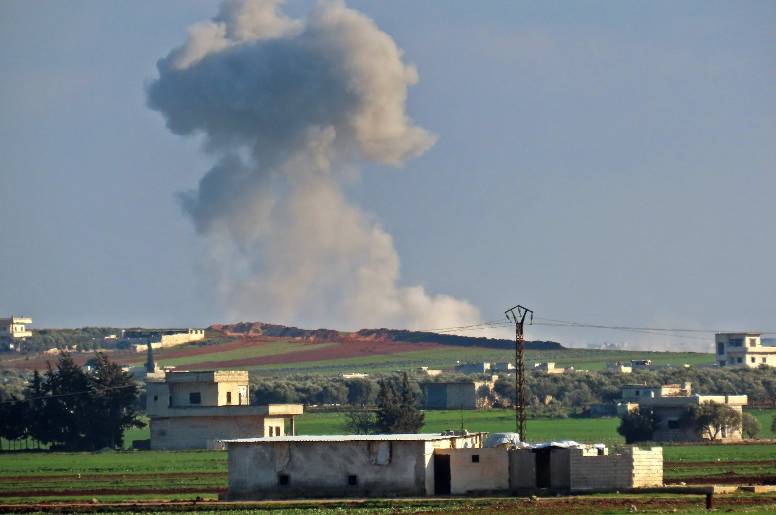 Smoke seen billowing following an airstrike by pro-regime forces near the town of Saraqib in the eastern part of the Idlib province in northwestern Syria, March 2, 2020. (AFP Photo)