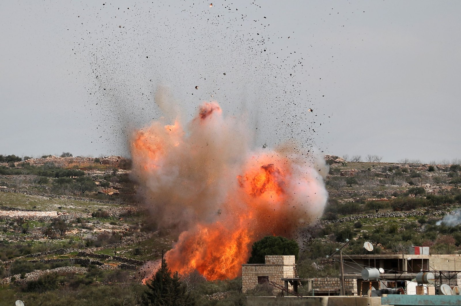A picture taken on March 5, 2020 shows an explosion following airstrikes on the village of al-Bara in the southern part of Syria's northwestern Idlib province. (AFP File Photo)