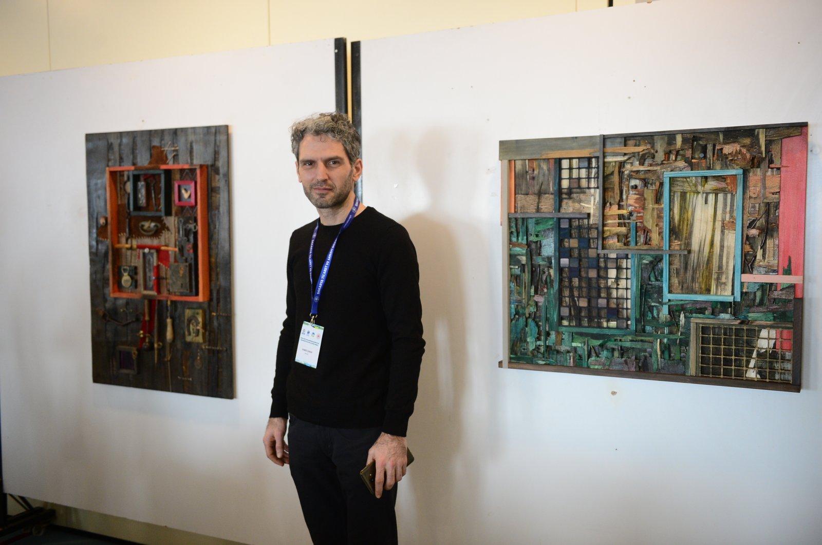 Hamdi Çınar poses in front of his artwork. (AA Photo)