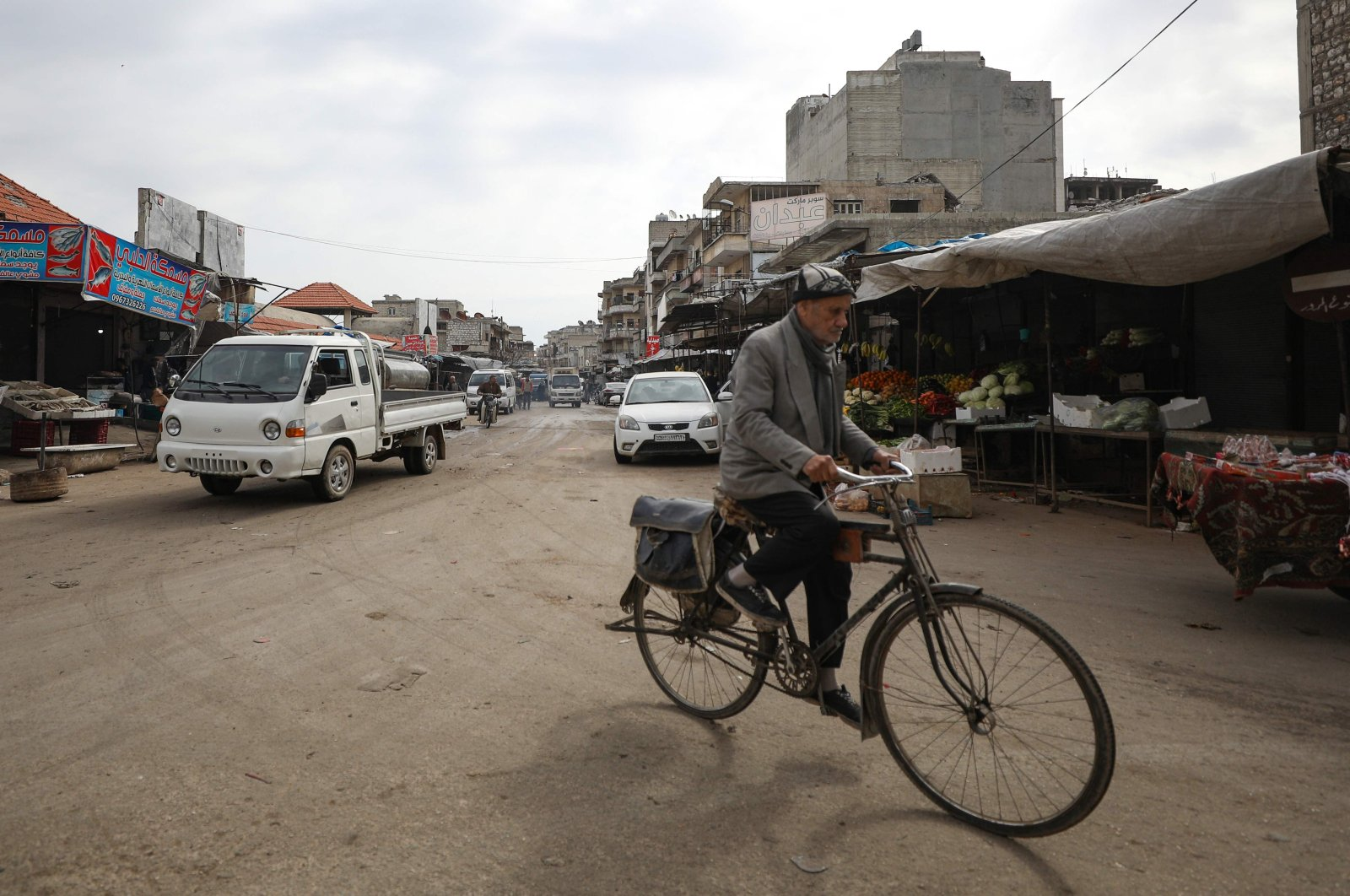 A man rides his bicycle in a street of the northwestern Syrian city of Idlib on March 6, 2020. - Syria's war-ravaged northwest woke up to relative calm today, its skies free of warplanes for the first day in months, following a Russian-Turkish ceasefire deal. (AFP Photo)