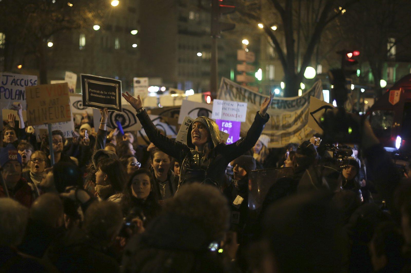 Women protest near the venue of the Cesar awards ceremony, Paris, Feb. 28, 2020. (AP Photo)