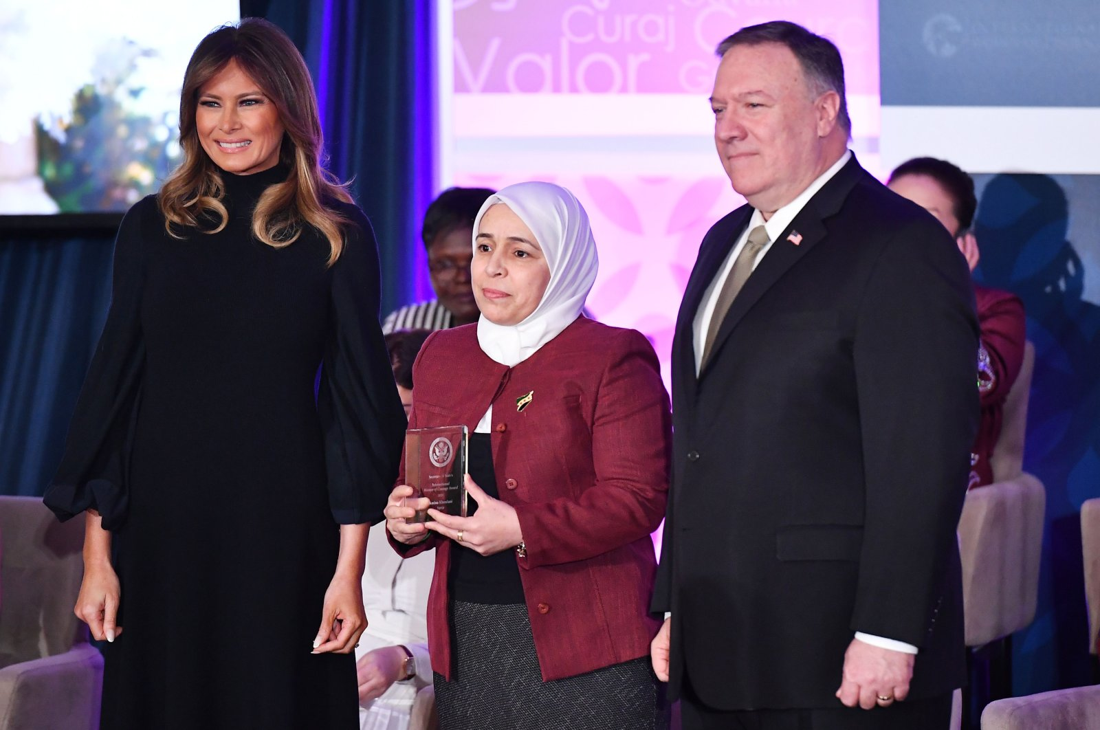 International Women of Courage (IWOC) Award recipient Amina Khoulani of Syria poses with US Secretary of State Mike Pompeo and First Lady Melania Trump at the State Department in Washington, DC on March 4, 2020. (AFP Photo)