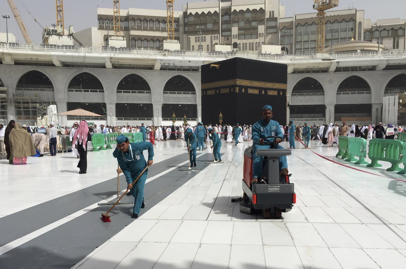 Workers clean the Grand Mosque, during the minor pilgrimage, known as Umrah, in the Muslim holy city of Mecca, Saudi Arabia, March 2, 2020. (AP Photo)