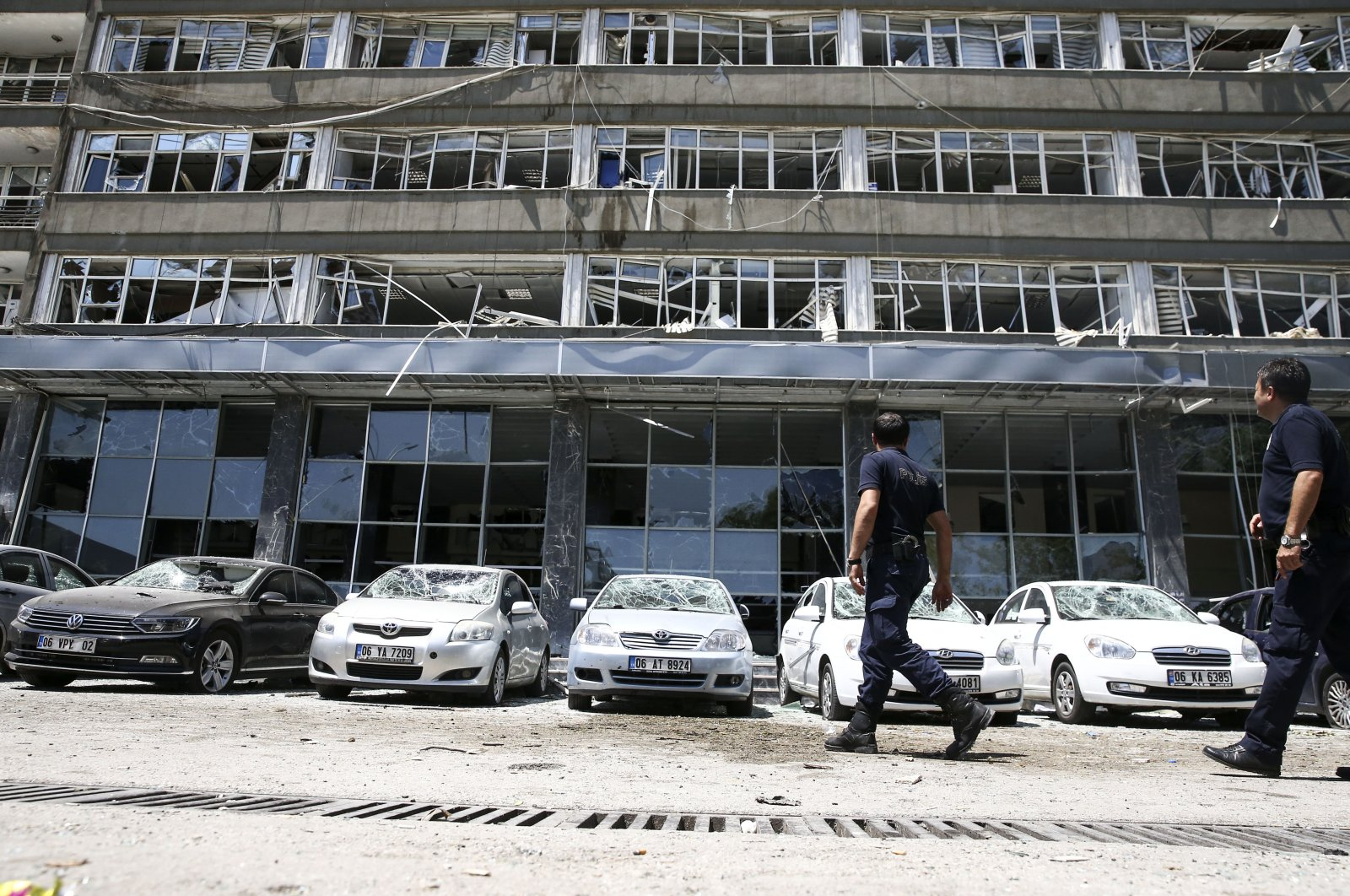 This undated photo shows a building inside the compound that houses the Ankara branch of the Turkish National Police and cars outside damaged in attacks by putschists. (AA Photo)