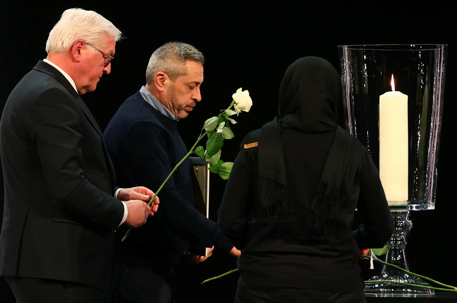 German President Frank-Walter Steinmeier and relatives of victims of the shootings in Hanau lay flowers during the memorial service in Hanau, Germany, March 4, 2020. (AFP Photo)