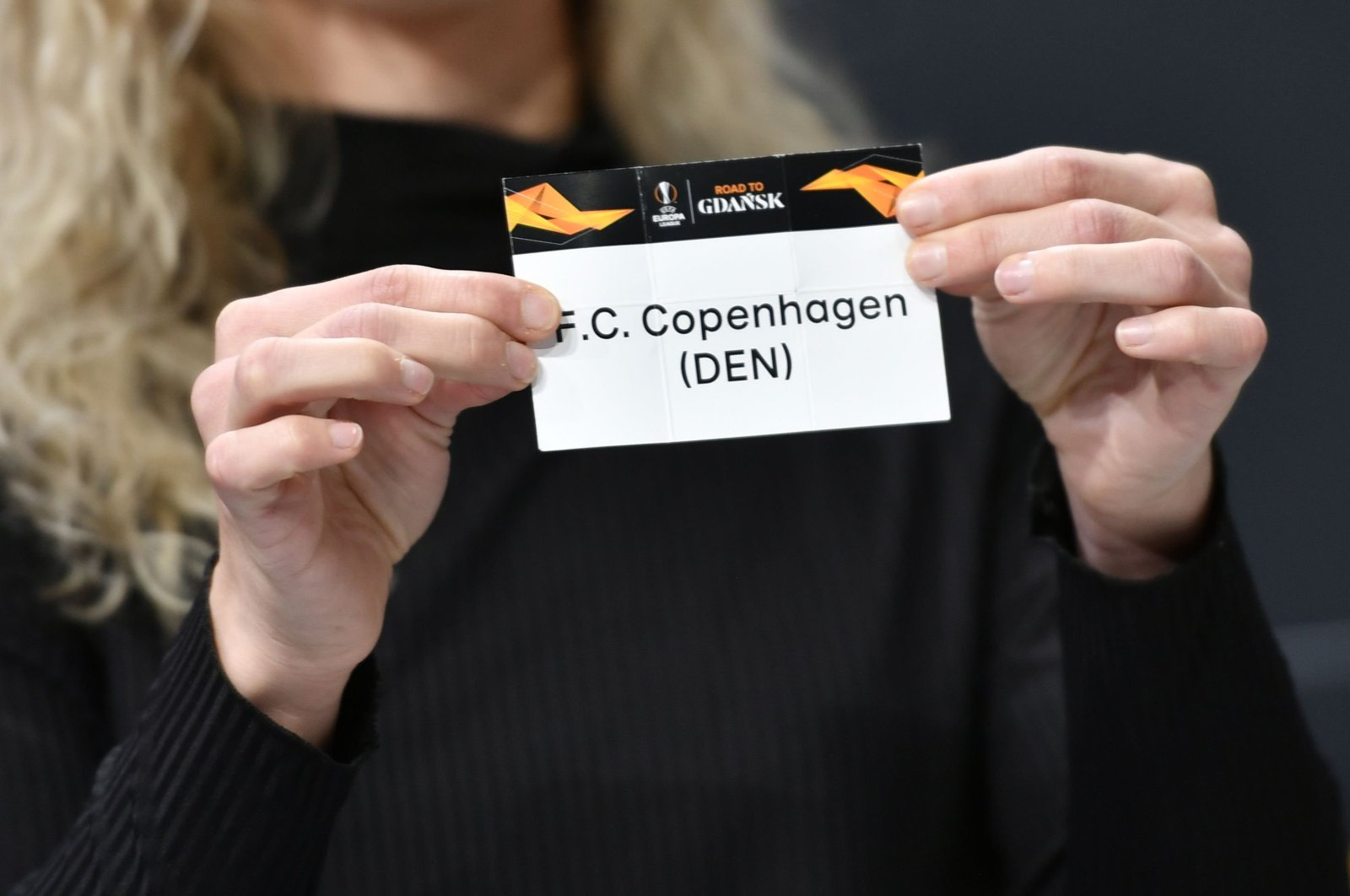 UEFA Europa League ambassador Josephine Henning holds the slip of FC Copenhagen during the UEFA Europa League football cup round of 32 draw ceremony in Nyon, Dec.16, 2019. (AFP Photo)
