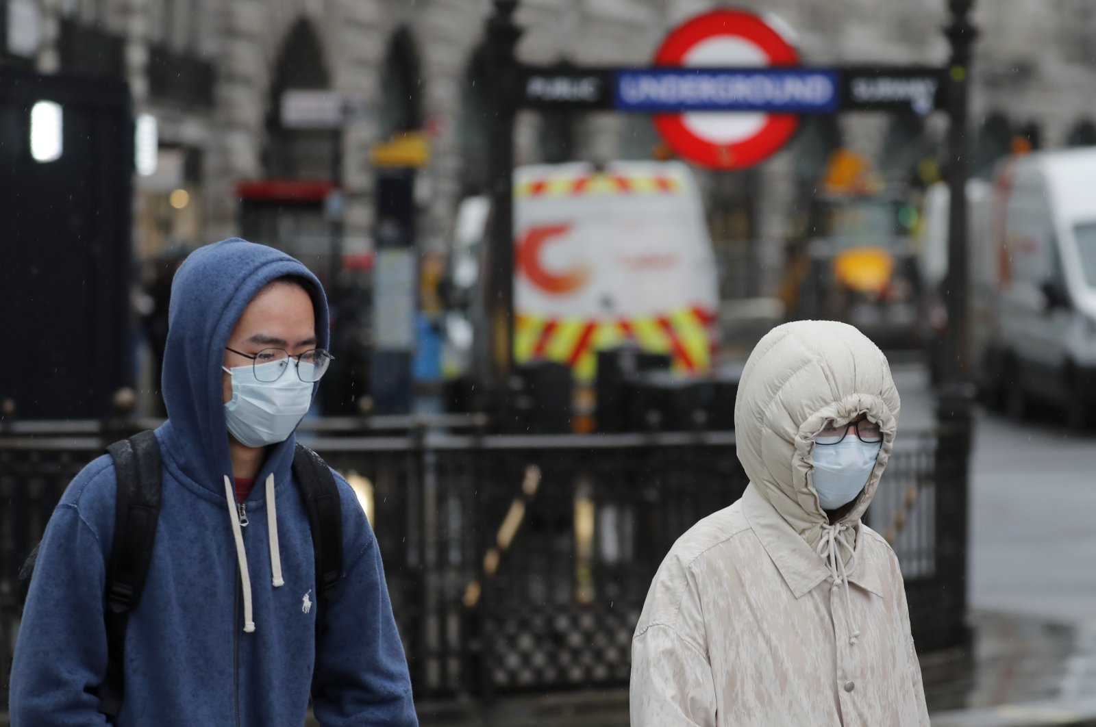 Pedestrians wear face masks as they walk in London's main tourist destination, Piccadilly Circus, March 5, 2020. (AP Photo)