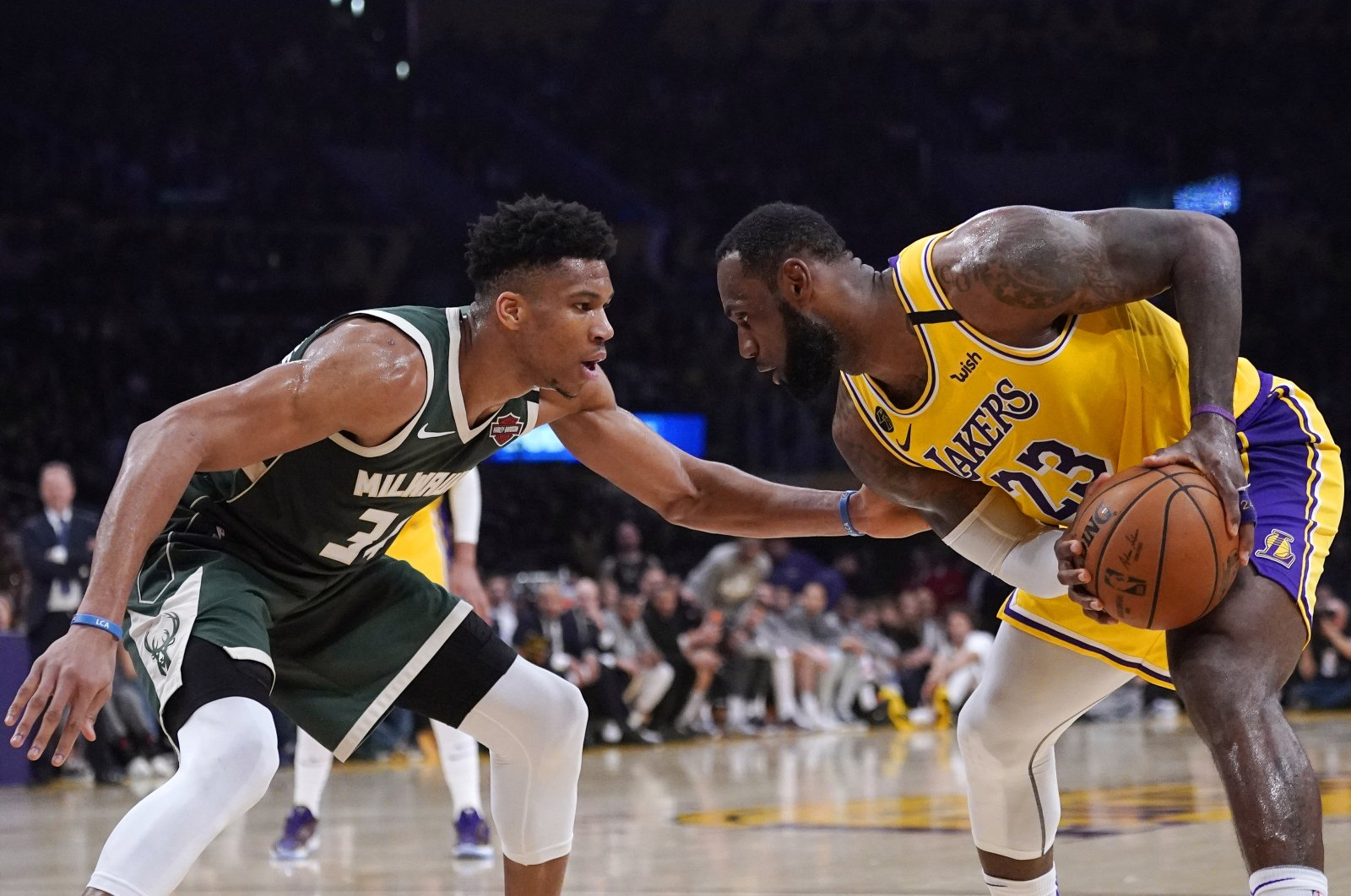 Los Angeles Lakers forward LeBron James, tries to get past Milwaukee Bucks forward Giannis Antetokounmpo during the second half of an NBA basketball game Friday, March 6, 2020, in Los Angeles. (AP Photo)