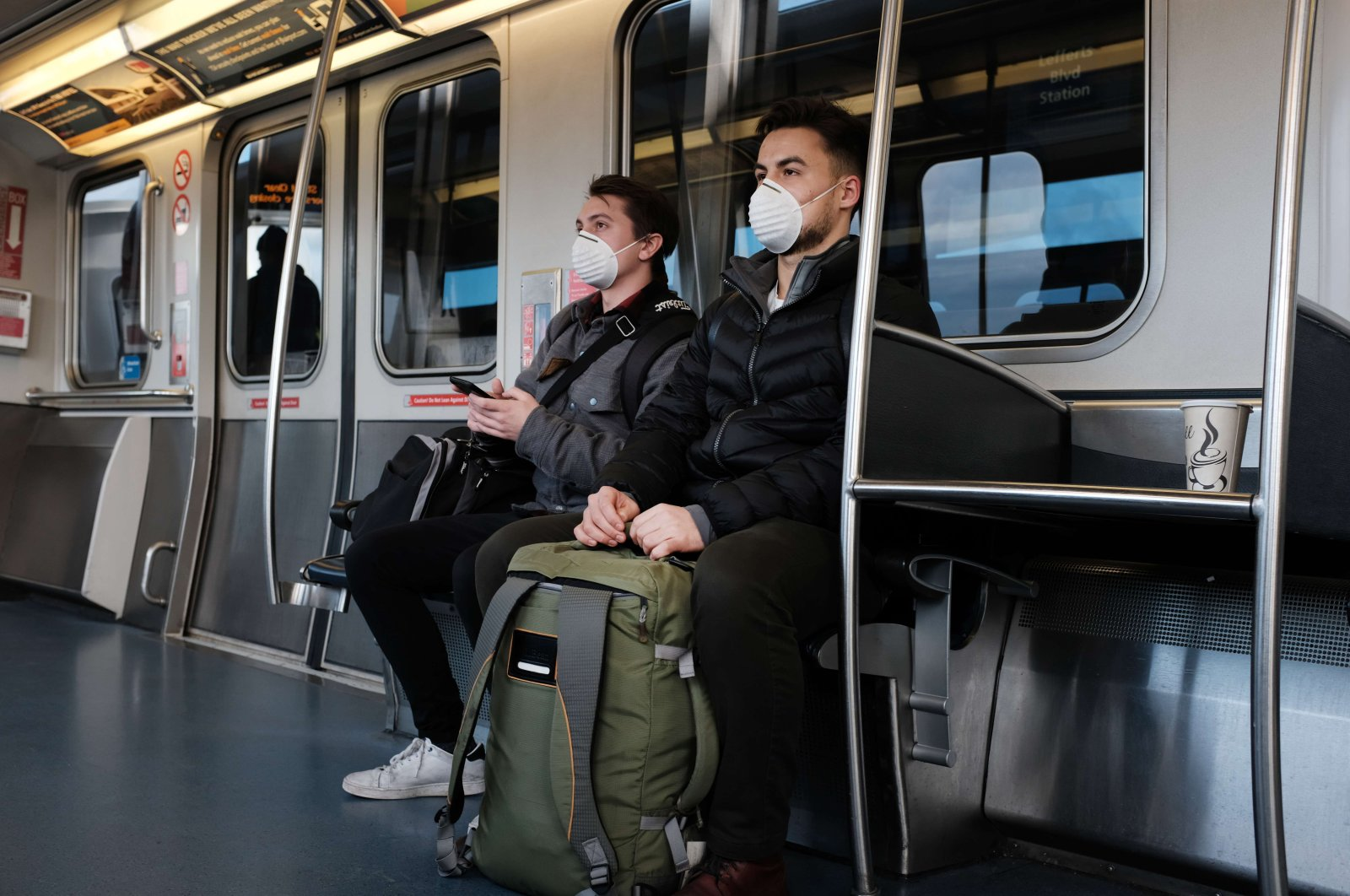 People wear medical masks on the AirTrain as concern over the coronavirus grows enroute to John F. Kennedy Airport (JFK) on March 7, 2020 in New York City. (AFP Photo)