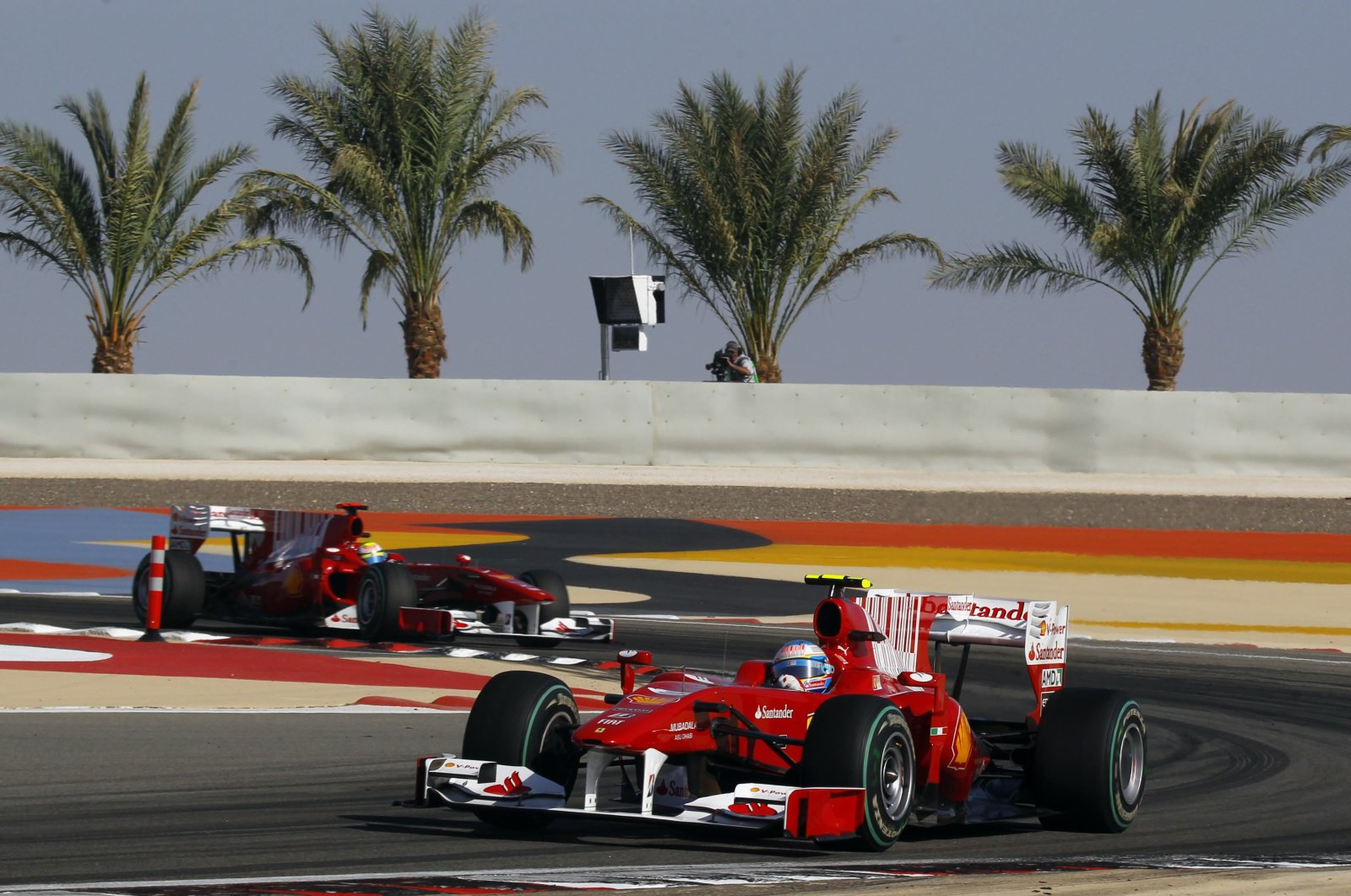 Ferrari Formula One driver Fernando Alonso of Spain leads teammate Felipe Massa of Brazil during the Bahrain F1 Grand Prix at Sakhir circuit in Manama March 14, 2010. (Reuters File Photo)