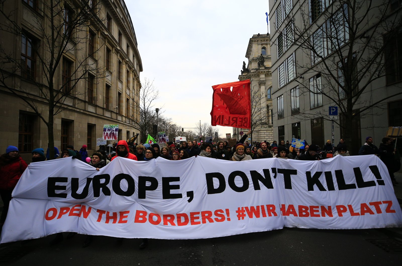 """Protesters in German capital Berlin called on the EU to open borders to refugees, writing on banners, """"Europe, don't kill!"""" March 7, 2020. (AA Photo)"""
