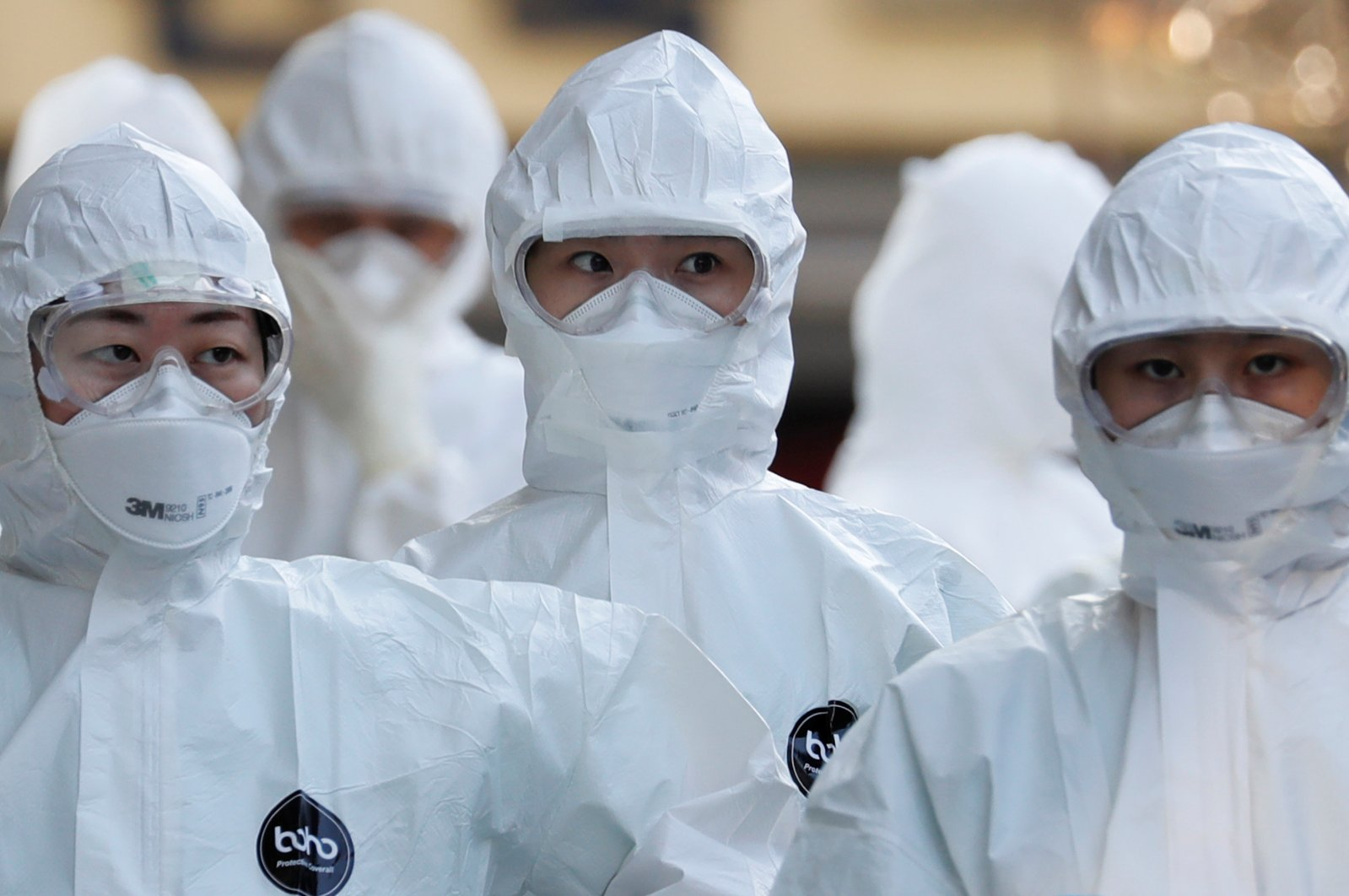 Medical workers in protective gears walk into a hospital facility to treat coronavirus patients amid the rise in confirmed cases in Daegu, South Korea, March 8, 2020. (Reuters Photo)
