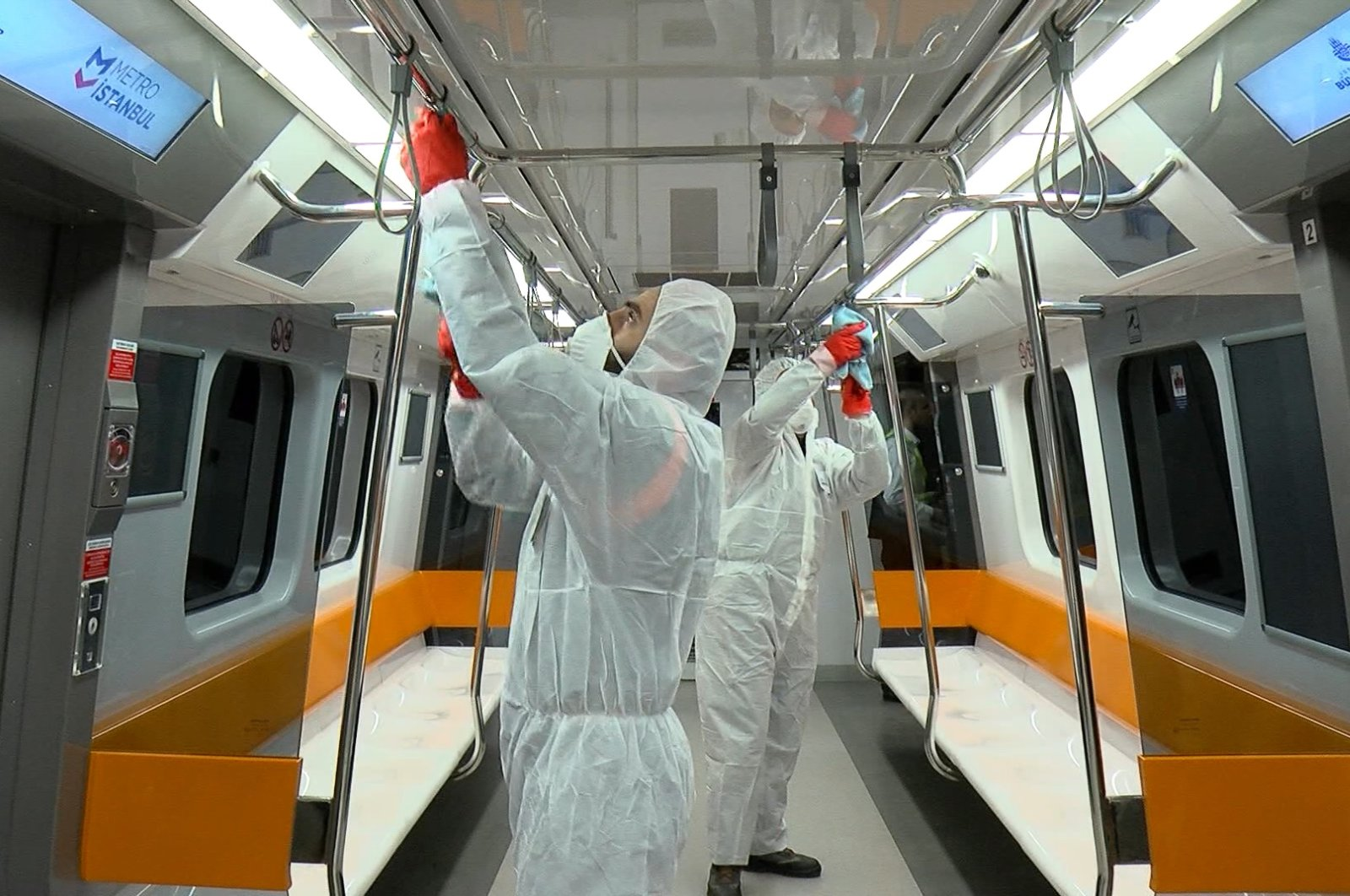 Health workers disinfect Istanbul's metro trains during off hours, March 4, 2020. (DHA Photo)