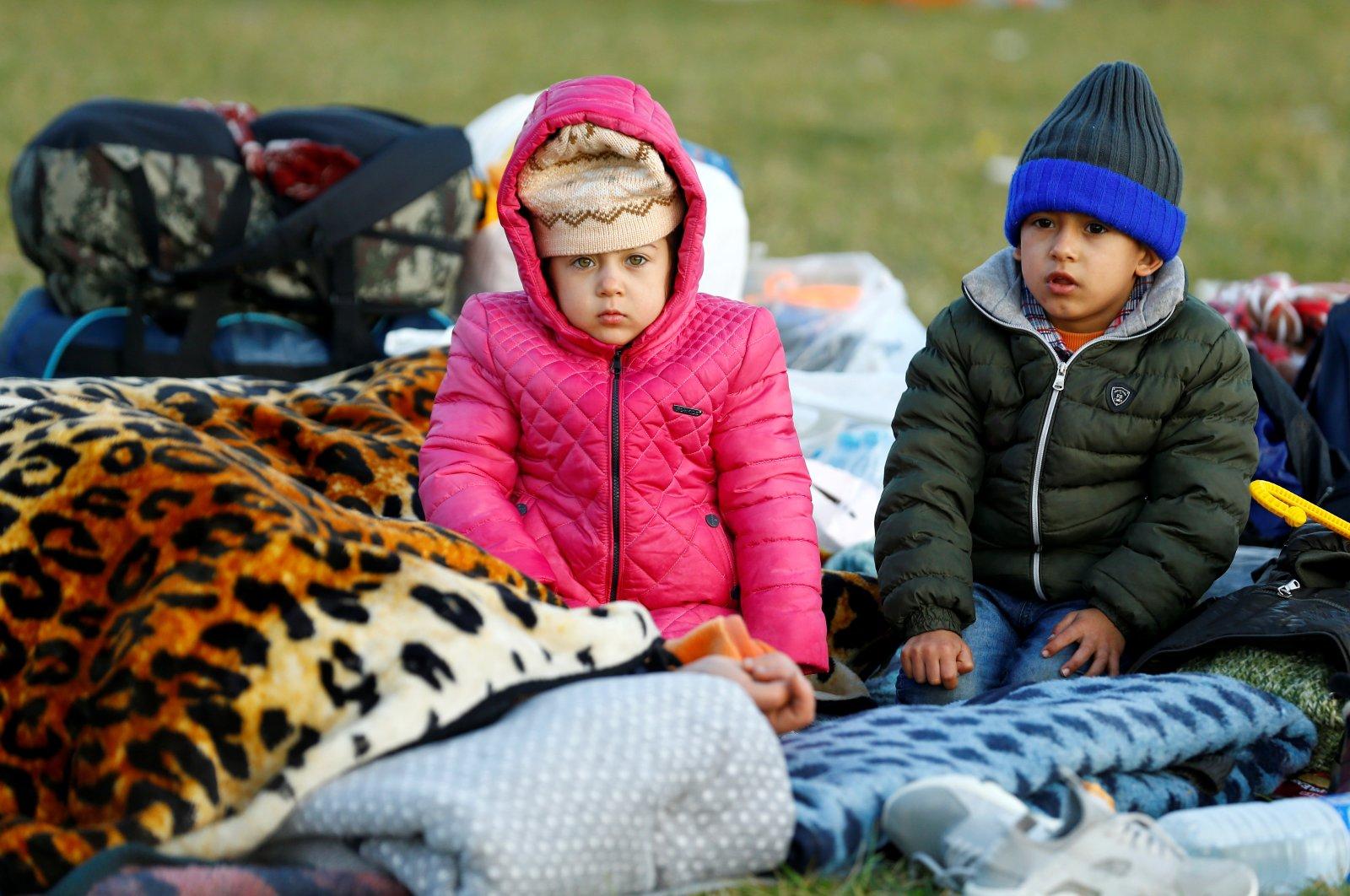 Migrant children are seen near Turkey's Pazarkule border crossing with Greece's Kastanies, near Edirne, Turkey, March 7, 2020. (Reuters Photo)