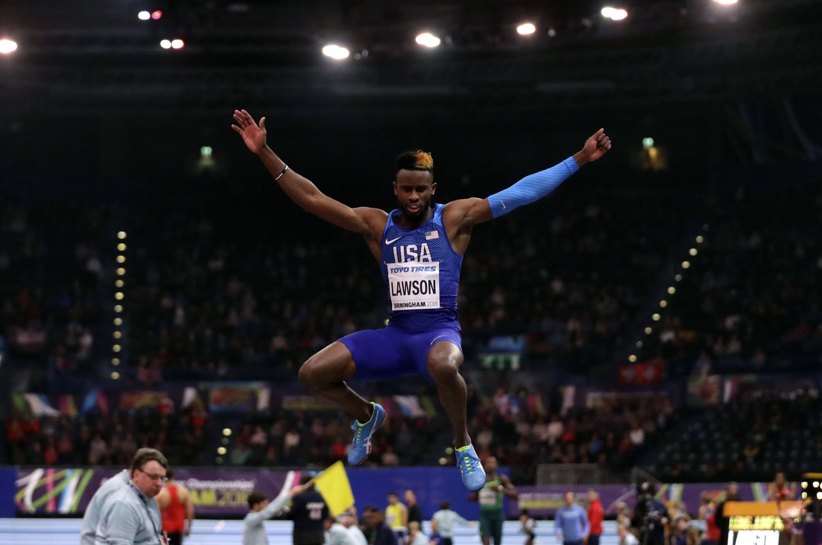 Jarrion Lawson makes an attempt in the men's long jump final, Birmingham, United Kingdom, Mar. 2, 2018. (AP Photo)