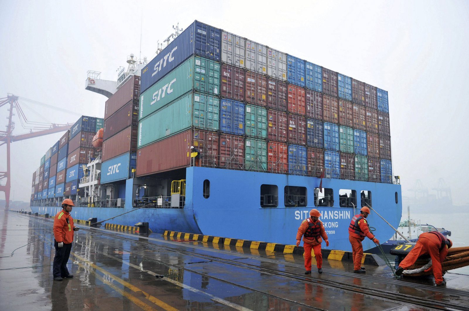 In this file photo workers can be seen mooring a container ship at a port in Qingdao in East China's Shandong province, Jan. 11, 2019. (AP Photo)