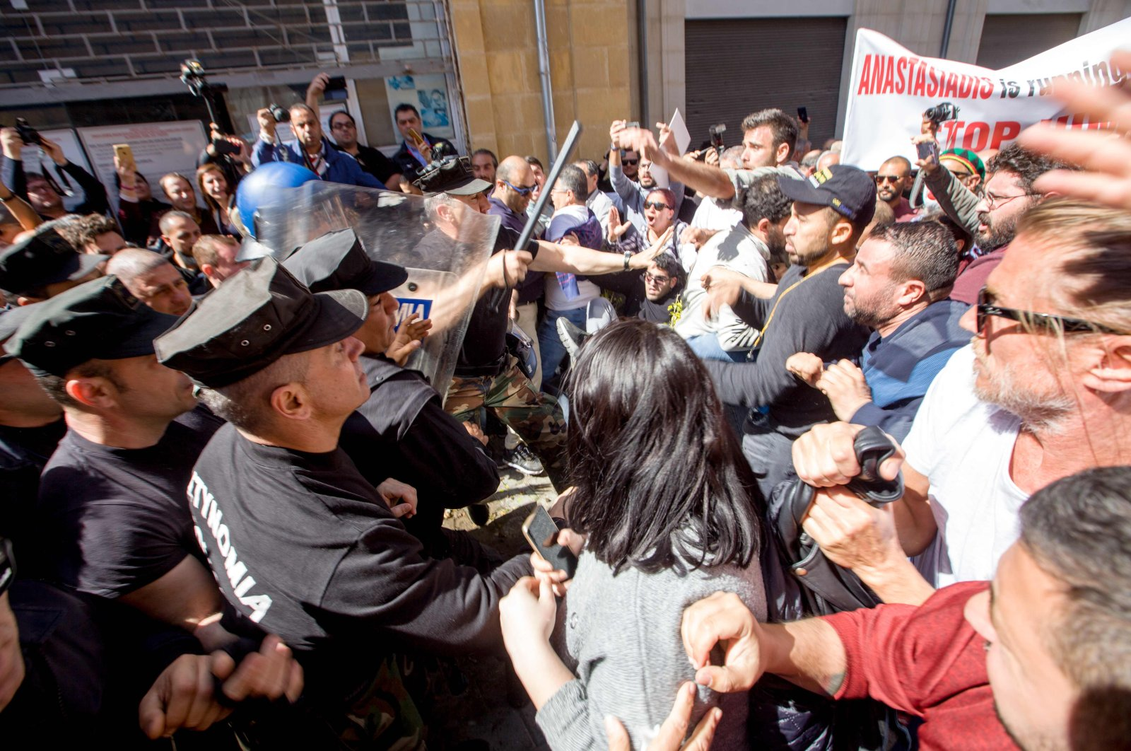 Protesters clash with Greek Cypriot police during a demonstration on March 7, in the U.N. buffer zone separating the island from TRNC and Greek, Cypriots over fears of the spread of COVID-19 coronavirus. (AFP Photo)