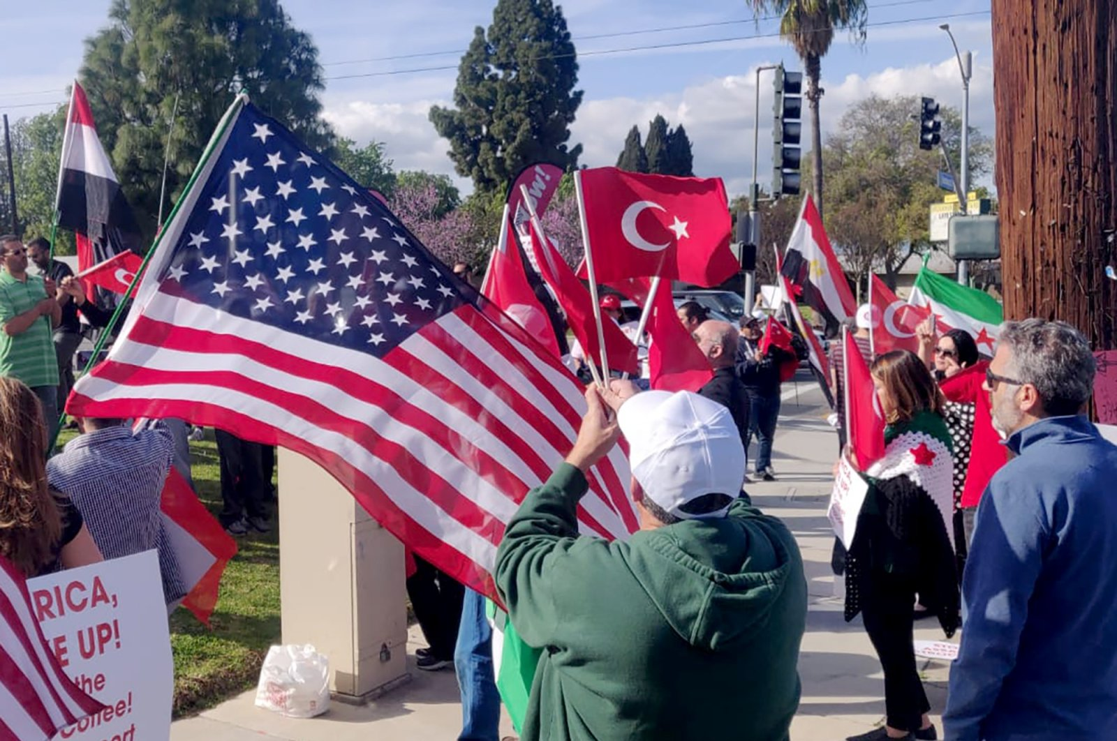 Demonstrators carrying Turkish, American and Syrian flags in their hands gathered in Los Angeles' Anaheim city in solidarity with Turkish soldiers in Idlib, March 9, 2020. (IHA PHOTO)
