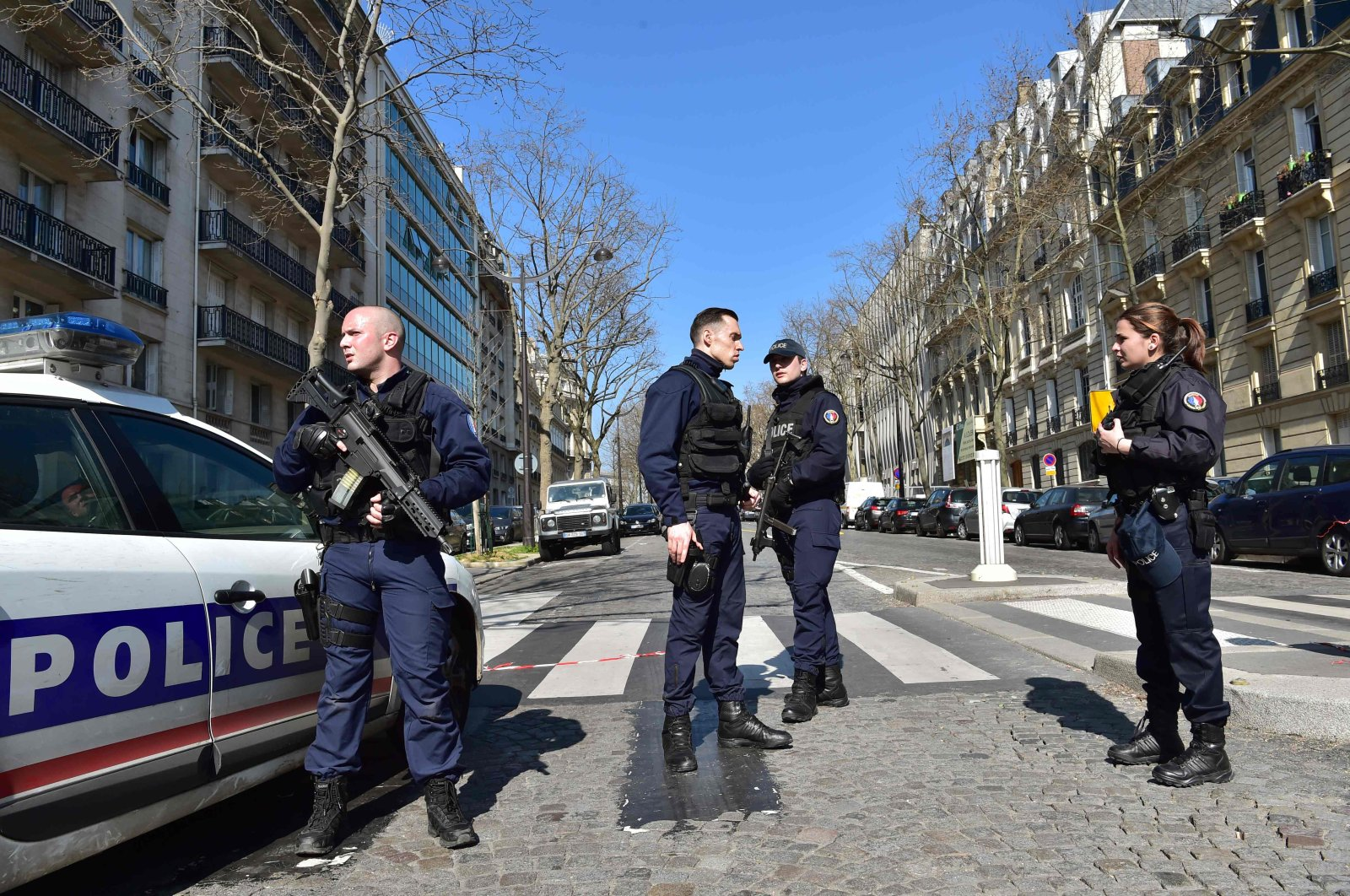 French Police officers secure the scene near the Paris offices of the International Monetary Fund (IMF), March 16, 2017.