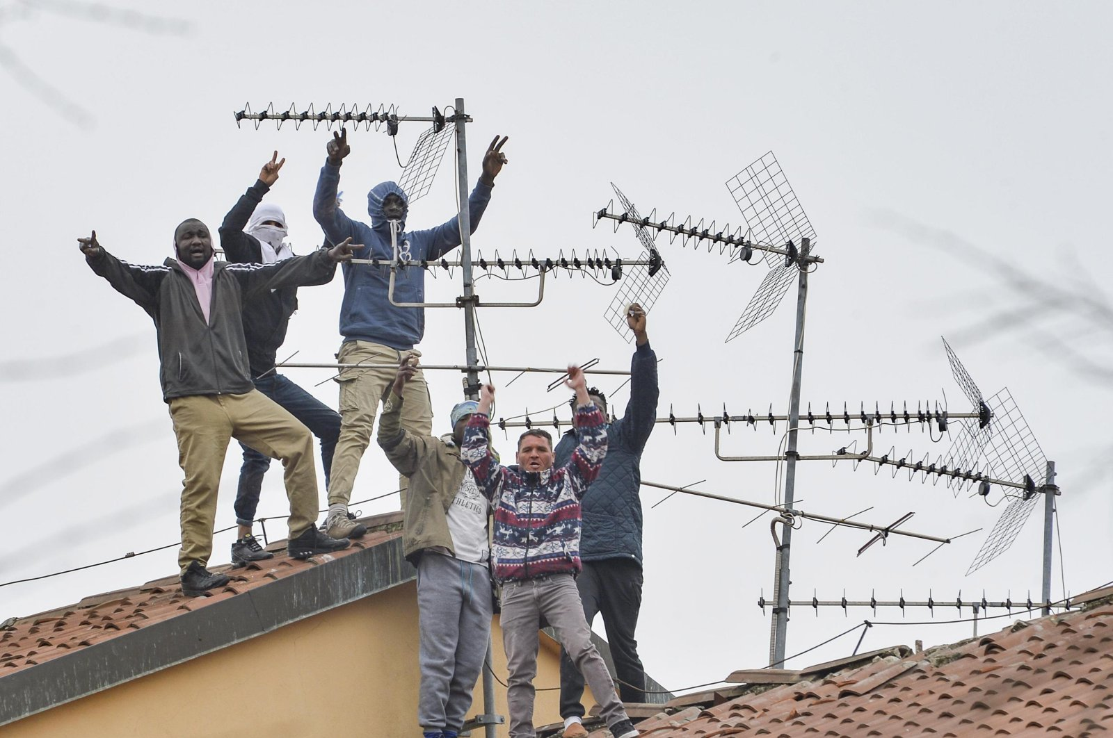 Detainees protest on the roofs of the San Vittore Prison in Milan, northern Italy, March 9, 2020. (EPA Photo)