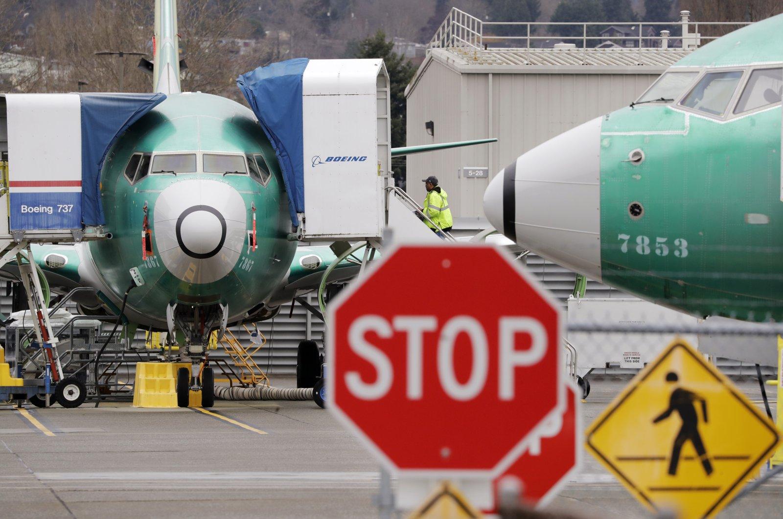 Boeing 737 MAX jets sit parked in Renton, Washington, Dec. 16, 2019. (AP Photo)