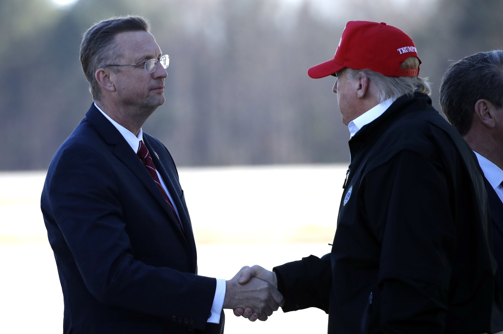 President Donald Trump greets Rep. Doug Collins, R-Ga., as he arrives on Air Force One Friday, March 6, 2020, at Dobbins Air Reserve Base in Marietta, Ga. (AP Photo)